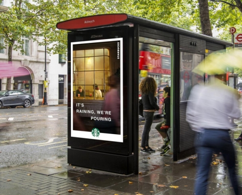 Posterscope's dynamic campaign for Starbucks displayed on a D6 Sheet on a raining street